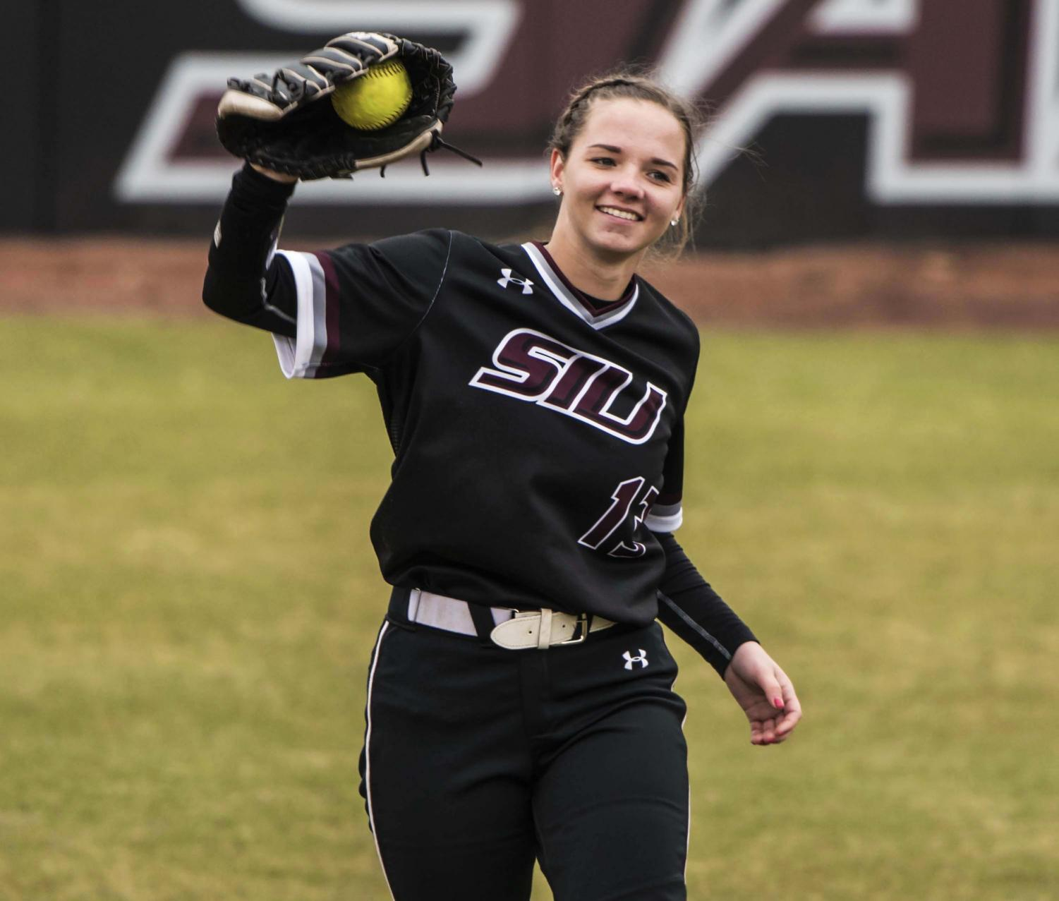 Outfielder+Maris+Boelens+smiles+as+she+catches+the+ball+on+Friday%2C+Feb.+22%2C+2019+during+the+Salukis+3-0+win+against+Ohio+University+at+Charlotte+West+Stadium.+