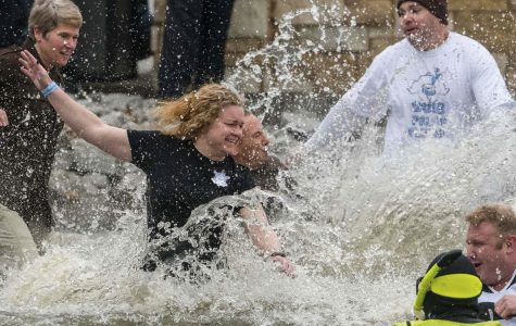 Jackson County officers plunge into the 42 degree water on Saturday, Feb. 23, 2019 during the Polar Plunge in support of the for the Special Olympics Illinois at SIU Campus Lake.