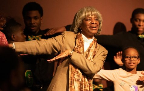 Pamela Smoot, history assistant professor, dances on stage with the Gentlemen of Vision Monday, Feb. 4, 2019 inside the Student Center Auditorium. The Gentlemen of Vision are St. Louis area high school students and performed a step show during the Black History Month Kickoff event.