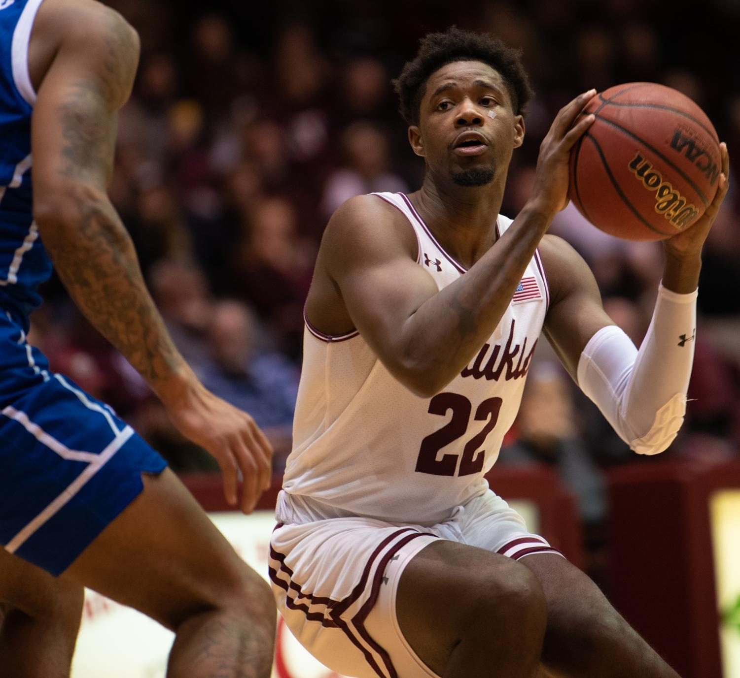 Saluki+senior+guard+Armon+Fletcher+looks+for+the+right+moment+to+go+for+the+basket+on+Tuesday%2C+Feb.+12%2C+2019+during+the+Saluki%27s+72-69+loss+against+the+Drake+Bulldogs+at+SIU+Arena.+