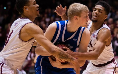 Saluki junior guard Eric McGill and junior guard Aaron Cook grapple for the ball on Tuesday, Feb. 12, 2019 during the Saluki's 72-69 loss against the Drake Bulldogs at SIU Arena.