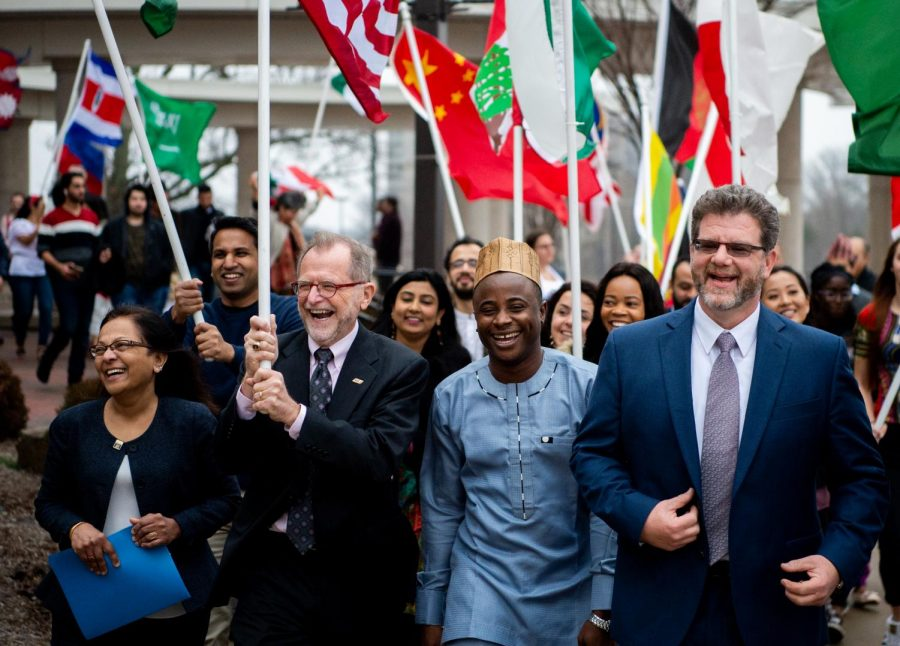 John M. Dunn, interim chancellor, parades across campus alongside Provost Meera Komarraju, Mayowa Olaoye, International Student Council Vice President of Finance and Andrew Carver, director for the Center of International Education on Monday, Feb. 4, 2019, during the the SIU International Week kickoff in Carbondale, Illinois.