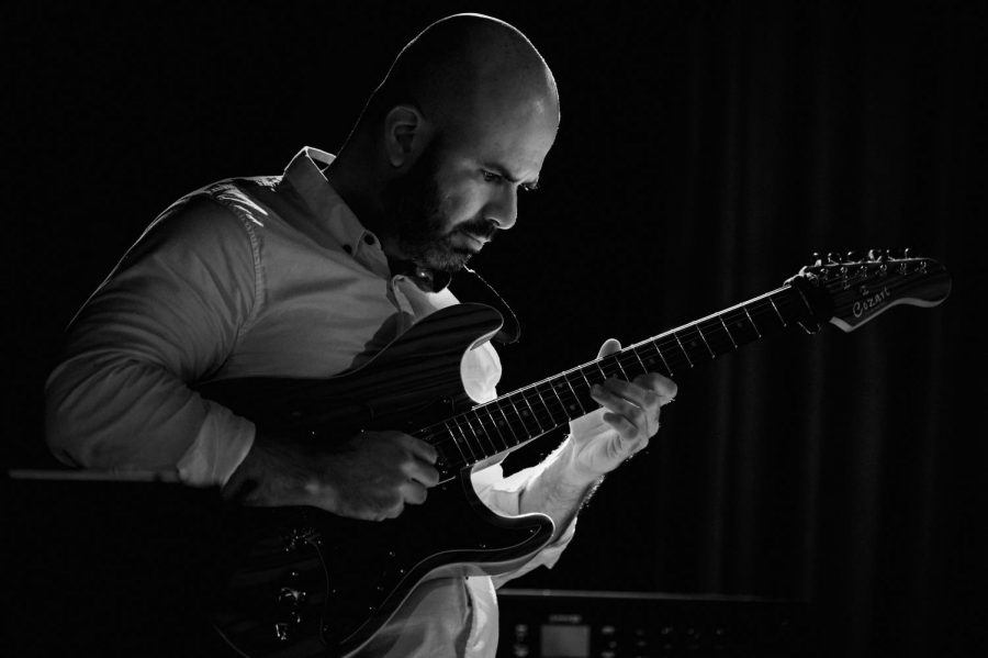 Isaac Lausell, assistant professor of guitar, performs with The Jazzicians of SIU on Friday, Feb. 22, 2019 at Hangar 9 in downtown Carbondale, Illinois.