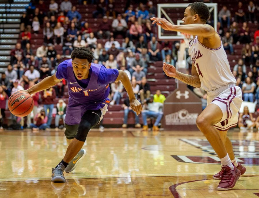Evansville Purple Aces guard Marty Hill drives the ball up the court on Saturday, Feb. 9, 2019, during the Southern Illinois Salukis' matchup against the Evansville Purple Aces at SIU Arena.