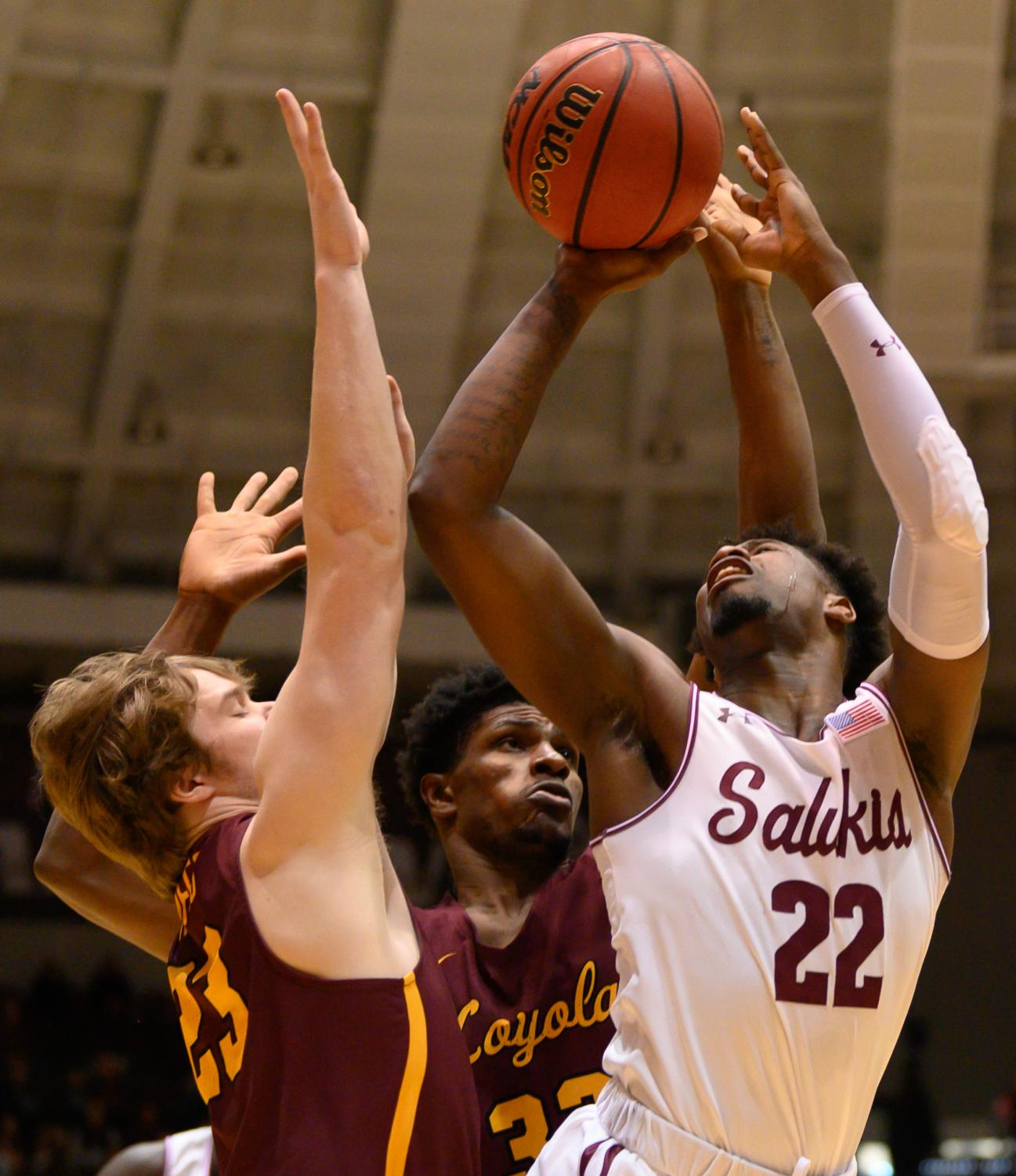 Southern+Illinois+Salukis+forward+Armon+Fletcher+goes+for+a+basket+while+under+pressure+from+Loyola+Ramblers+guard+Cooper+Kaifes+and+Ramblers+forward+Franklin+Agunanne+on+Sunday%2C+Feb.+24%2C+2019%2C+during+a+matchup+between+the+Southern+Illinois+Salukis+and+the+Loyola+Ramblers+at+SIU+Arena.