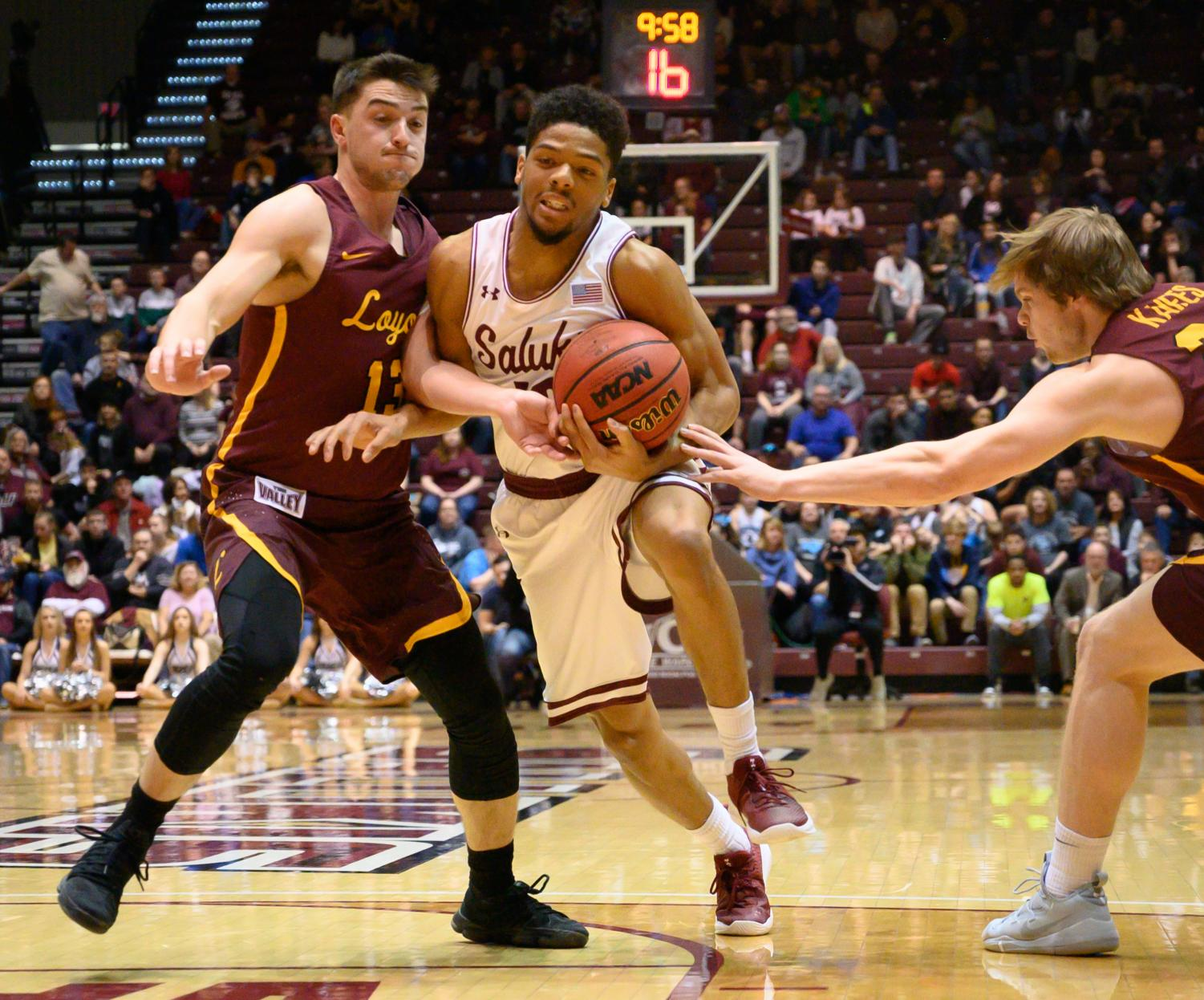 Southern+Illinois+Salukis+guard+Aaron+Cook+attempts+to+get+past+Loyola+Ramblers+guard+Clayton+Custer+and+Loyola+Ramblers+guard+Cooper+Kaifes+on+Sunday%2C+Feb.+24%2C+2019%2C+during+a+matchup+between+the+Southern+Illinois+Salukis+and+the+Loyola+Ramblers+at+SIU+Arena.