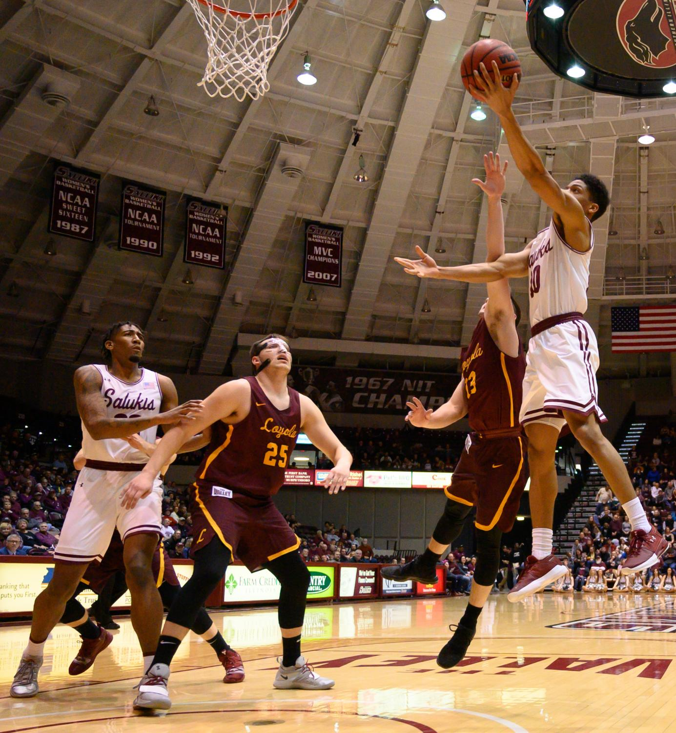 Southern+Illinois+Salukis+guard+Aaron+Cook+goes+for+a+basket+on+Sunday%2C+Feb.+24%2C+2019%2C+during+a+matchup+between+the+Southern+Illinois+Salukis+and+the+Loyola+Ramblers+at+SIU+Arena.