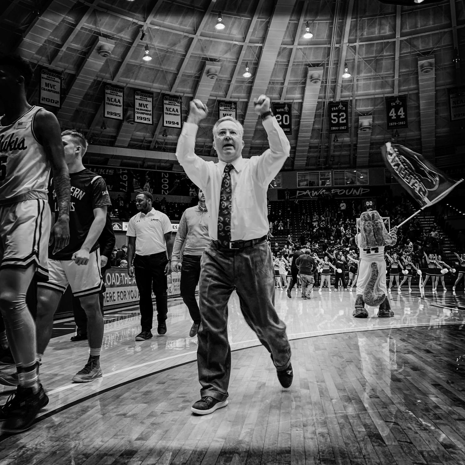 Barry+Hinson%2C+head+men%27s+basketball+coach%2C+celebrates+after+Southern+Illinois+Salukis%27+63-53+win+against+the+Loyola+Ramblers+on+Sunday%2C+Feb.+24%2C+2019+at+SIU+Arena.+The+images+in+this+collage+were+taken+with+an+iPhone+XS+Max+and+processed+in+Hipstamatic.