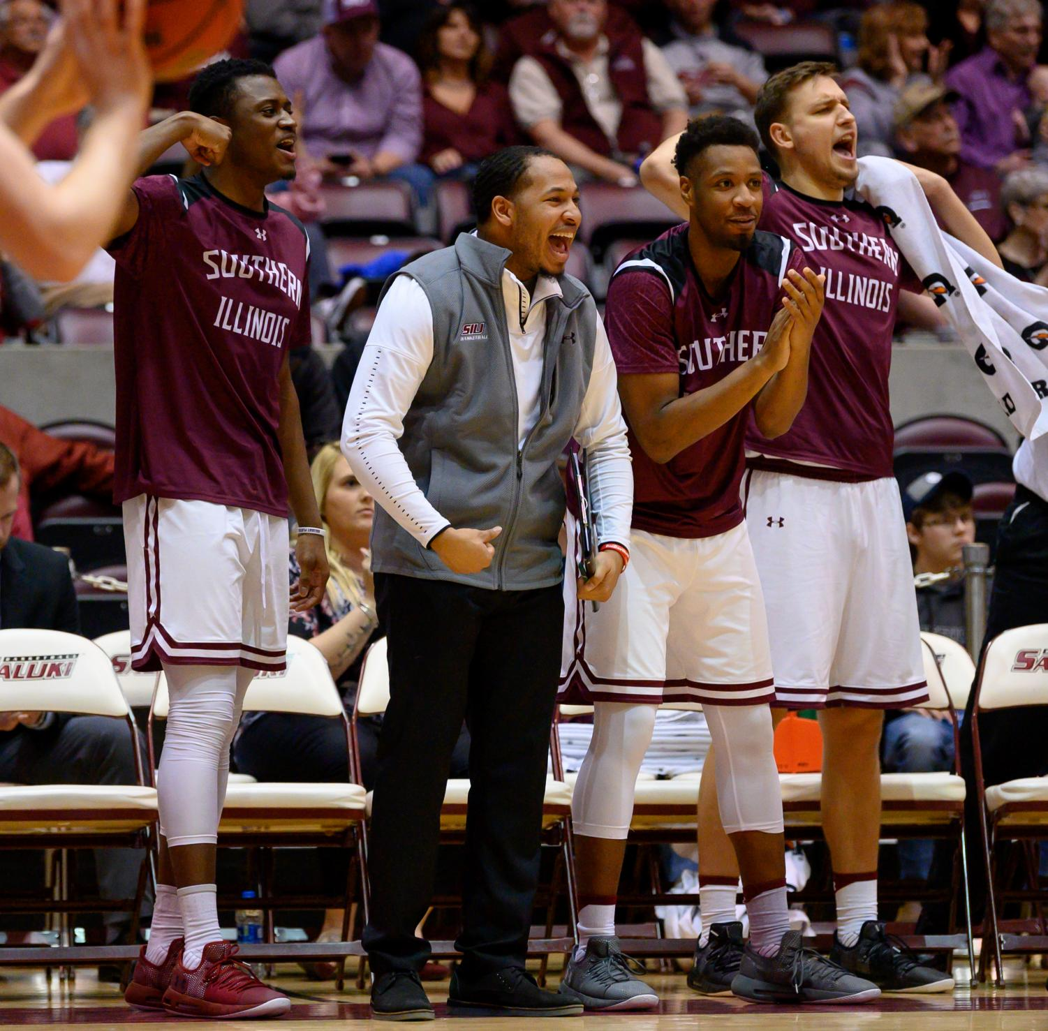 The+Salukis+bench+celebrates+a+basket+on+Sunday%2C+Feb.+24%2C+2019%2C+during+a+matchup+between+the+Southern+Illinois+Salukis+and+the+Loyola+Ramblers+at+SIU+Arena.