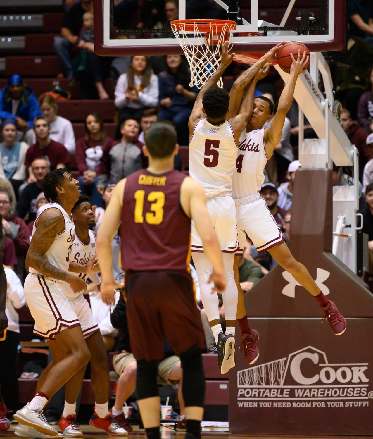 Southern+Illinois+Salukis+guard+Eric+McGill+and+Southern+Illinois+Salukis+guard+Darius+Beane+go+for+the+rebound+on+Sunday%2C+Feb.+24%2C+2019%2C+during+a+matchup+between+the+Southern+Illinois+Salukis+and+the+Loyola+Ramblers+at+SIU+Arena.