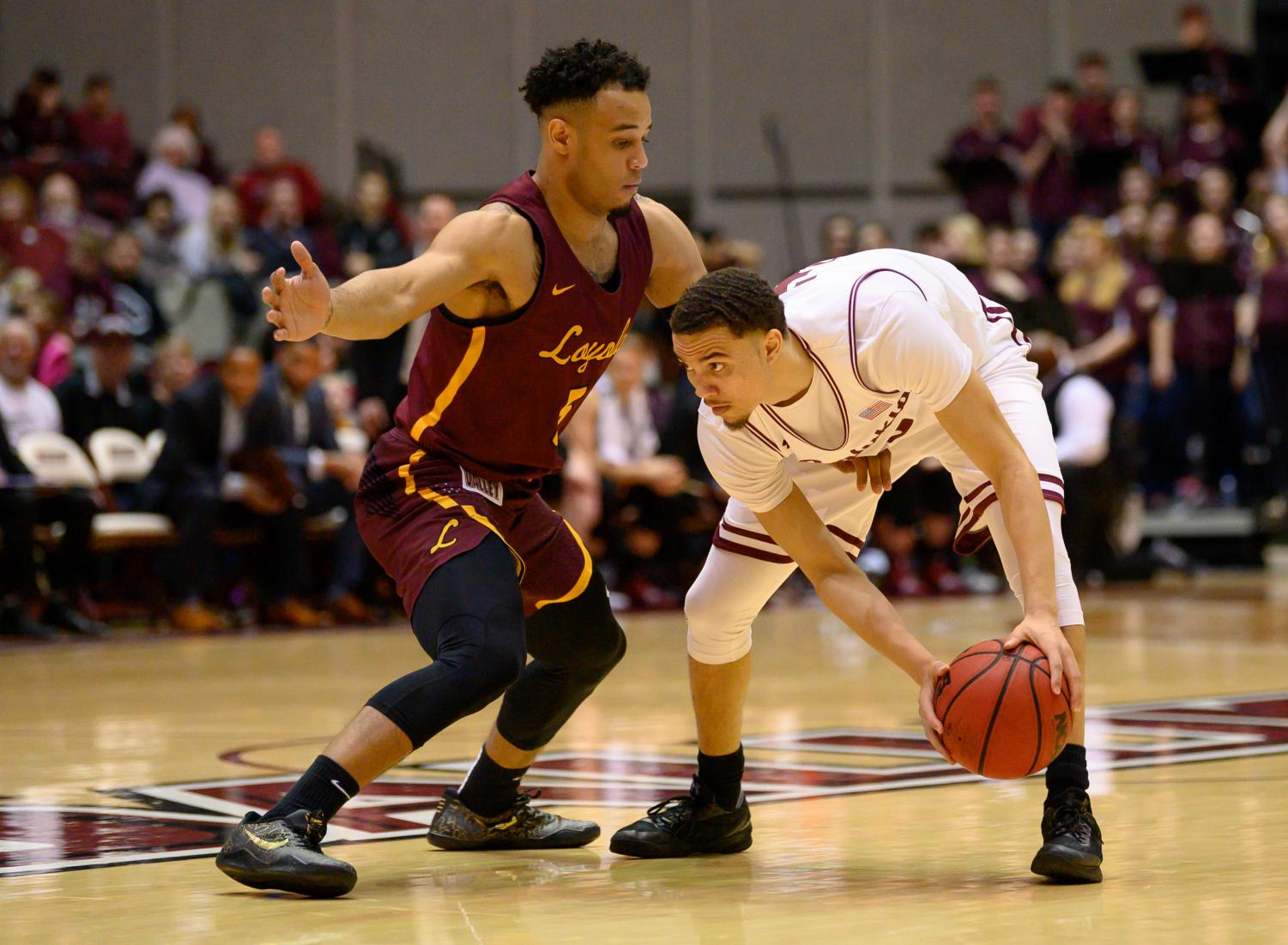 Southern+Illinois+Salukis+guard+Marcus+Bartley+attempts+to+get+past+Loyola+Ramblers+guard+Marques+Townes+on+Sunday%2C+Feb.+24%2C+2019%2C+during+a+matchup+between+the+Southern+Illinois+Salukis+and+the+Loyola+Ramblers+at+SIU+Arena.