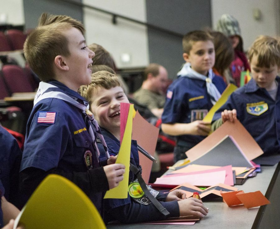 Cub scout Maxwell DeNeal, 9, of Cambria, laughs during a demonstration on Saturday, Feb. 16, 2019, at the SIU STEM University event in the Neckers science building.