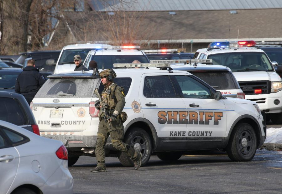 6 dead, including shooter, and 5 officers wounded in attack at Illinois manufacturing firm.