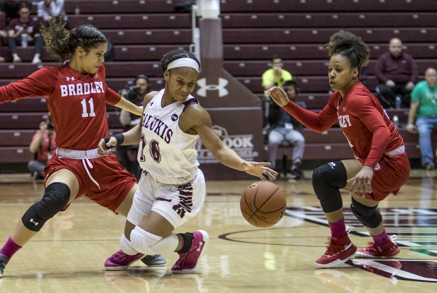 Saluki+junior+guard+Brittney+Patrick+fights+for+the+ball+on+Friday%2C+Feb.+15%2C+2019%2C+during+the+Salukis%27+55-62+win+against+the+Bradley+Braves+at+SIU+Arena.