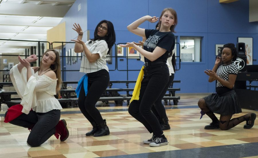 "The Carbondale Community High School K-Pop Dance Club dances on Wednesday, March 6, at the ""Unity in Diversity"" Multicultural Festival in the Carbondale Community High School."