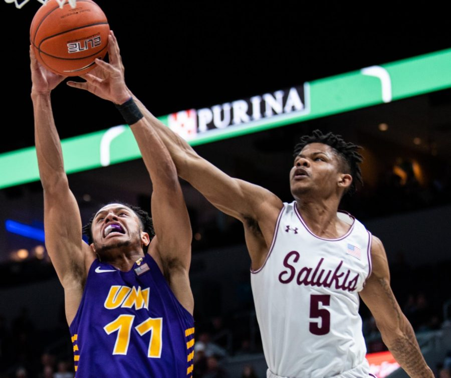 Saluki freshman guard Darius Beane goes for the ball on Friday, March 8, 2019 during the Salukis 58-61 loss against the University of Northern Iowa at the Enterprise Center in St. Louis, Missouri.