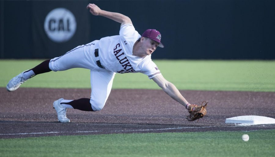 Saluki J.T. Weber dives for the ball on Tuesday, March 19, 2019 during the Salukis' 7-6 win against the SIUE Cougars at the Itchy Jones Stadium.