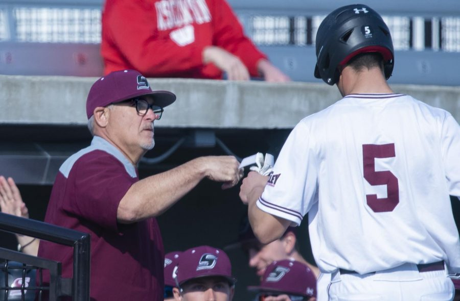 Saluki+Head+Coach+Ken+Henderson+fist+bumps+players+on+their+way+into+the+dugout+on+Tuesday%2C+March+19%2C+2019+during+the+Salukis%27+7-6+win+against+the+SIUE+Cougars+at+the+Itchy+Jones+Stadium.