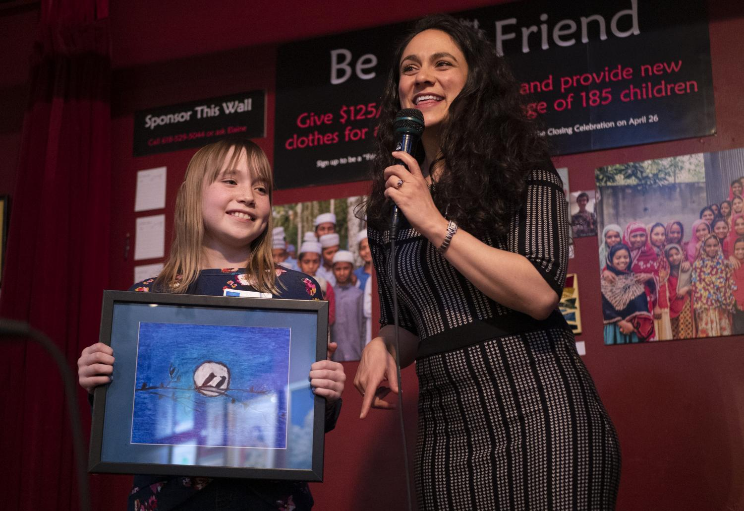 Elise Warshawsky presents her art alongside For Kids' Sake Director, Shema Ruperto, at the For Kids' Sake Art Auction on Friday, March 22, 2019, in Longbranch Cafe and Bakery.