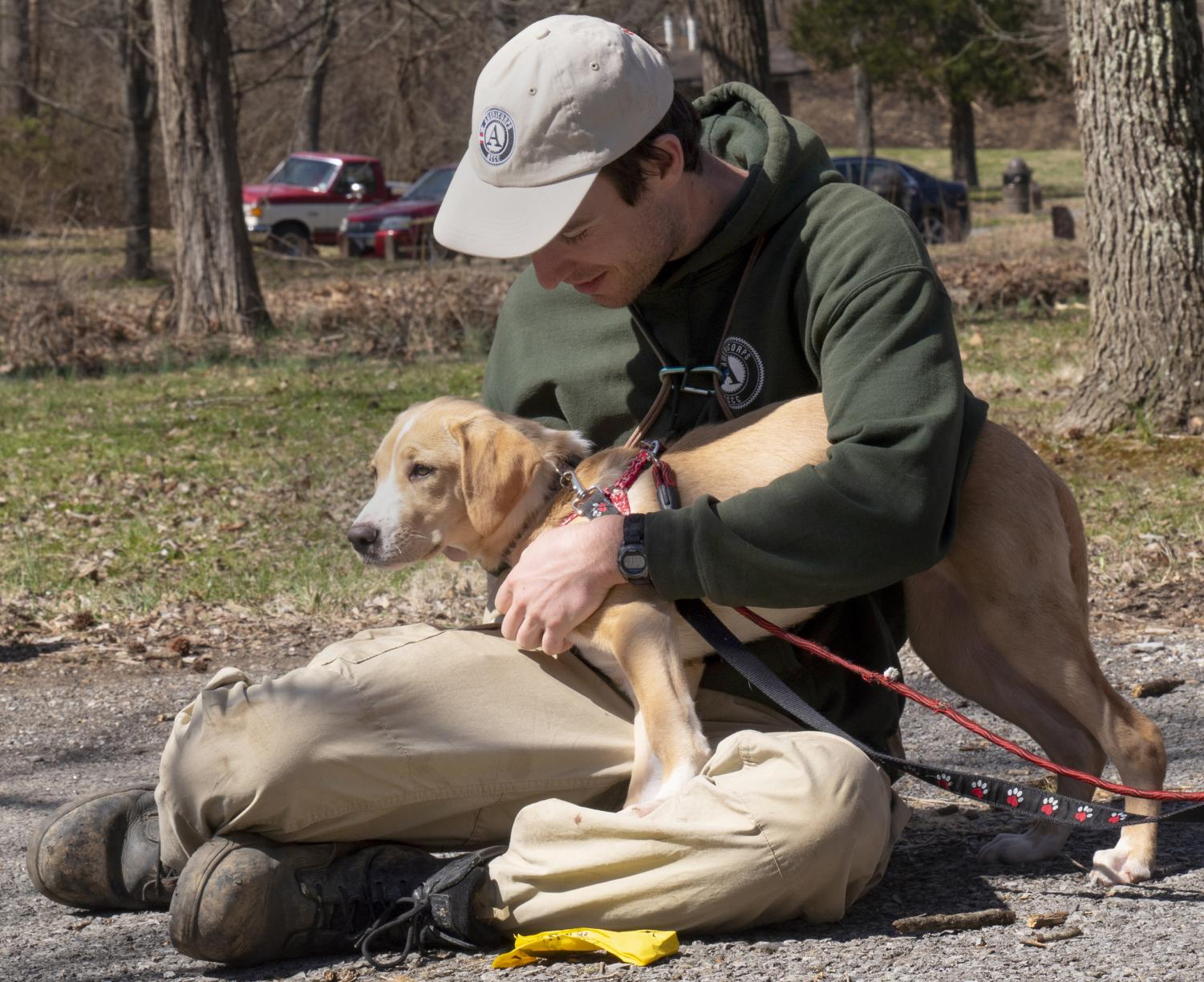 """Ted Randich pets Karen on Saturday, March 23, 2019, for Wright Way Animal Rescue's """"Hike with a Homeless Dog"""" event at Giant City State Park."""