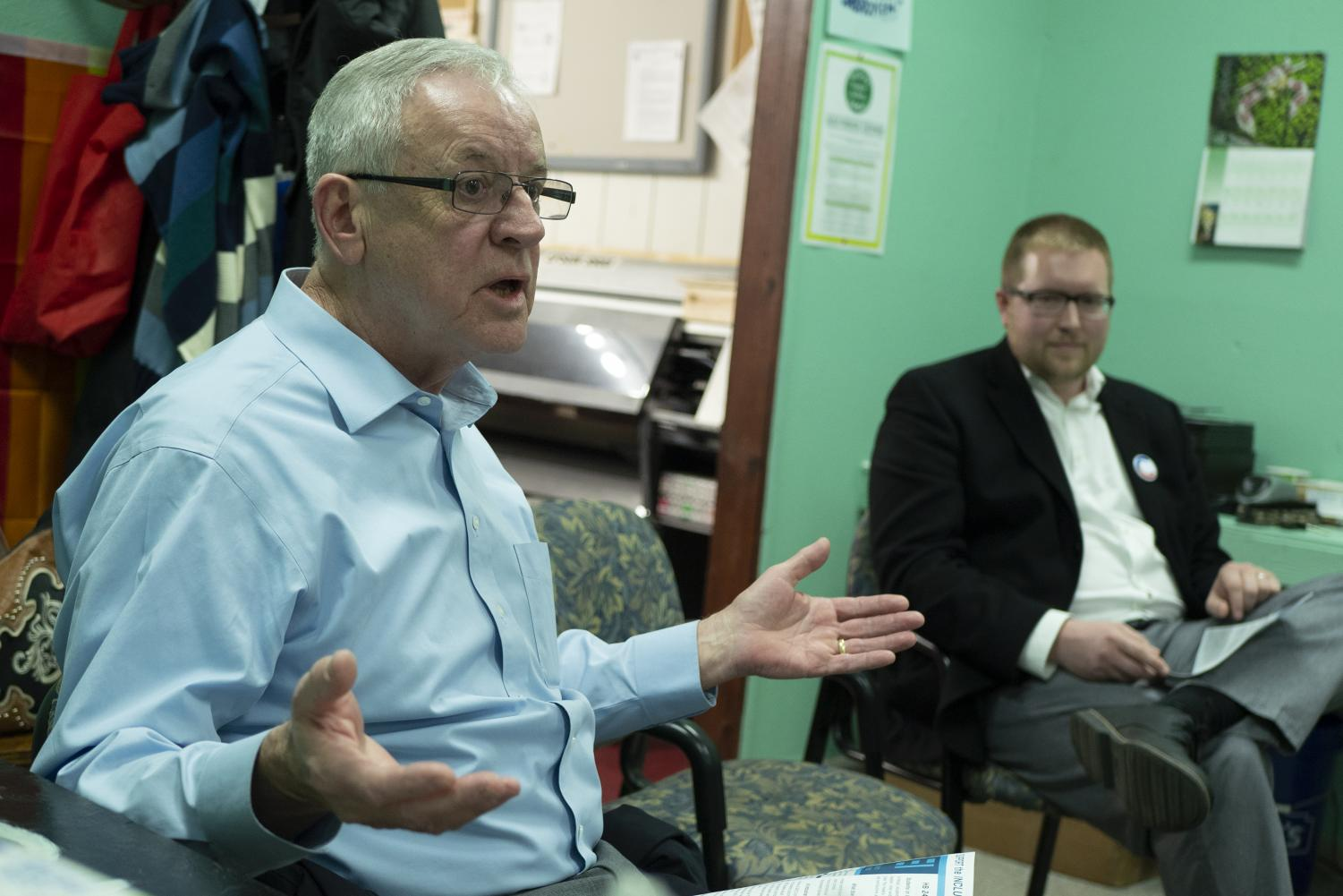 Mayor Mike Henry addresses a question alongside mayoral candidate Nathan Colombo on March 28, 2019, at the Mayoral LGBTQ Open Forum in the Center of Empowerment and Justice.