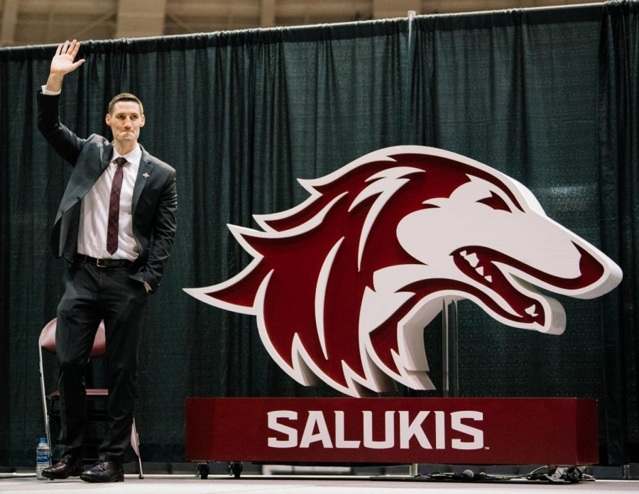 Bryan Mullins waves to the crowd on Thursday, March 22, 2019, during a town hall introducing Mullins as Southern's fourteenth head basketball coach at SIU Arena in Carbondale, Illinois.