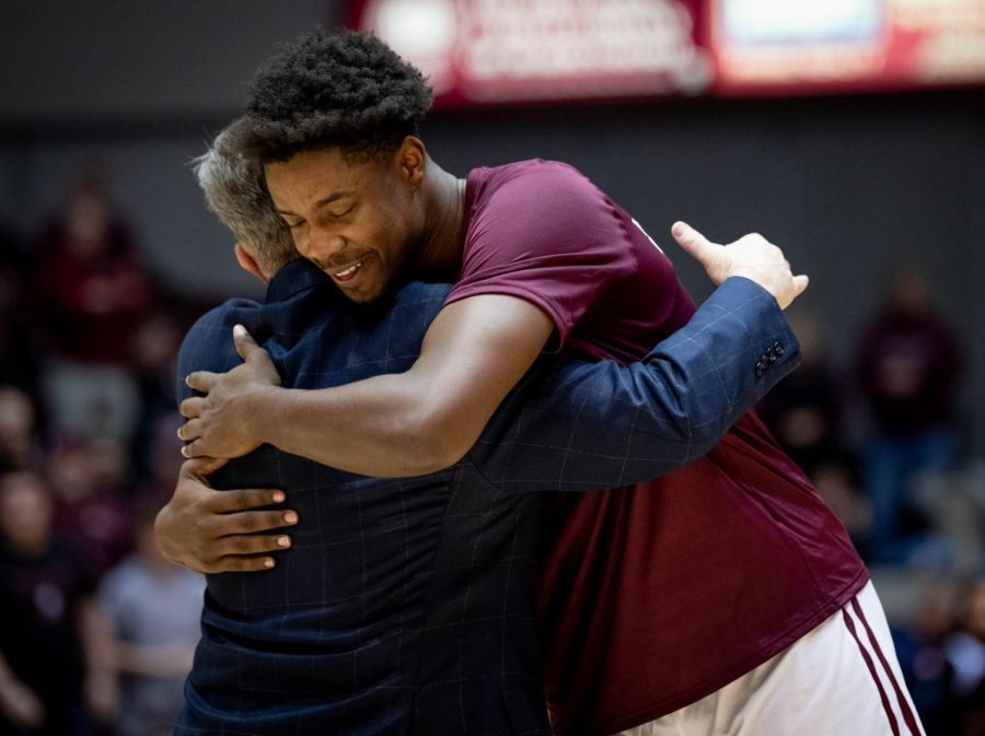 Forward+Armon+Fletcher+hugs+Southern+Illinois+Salukis+head+coach+Barry+Hinson+on+Saturday%2C+March+2%2C+2019+before+the+Southern+Illinois+Salukis%27+72-63+win+over+the+Illinois+State+Redbirds+at+SIU+Arena+in+Carbondale%2C+Illinois.+