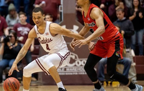 Southern Illinois Salukis guard Eric McGill attempts to get the ball past Illinois State Redbirds guard Zach Copeland on Saturday, March 2, 2019 during the Salukis' 72-63 win over the Illinois State Redbirds at SIU Arena in Carbondale, Illinois.