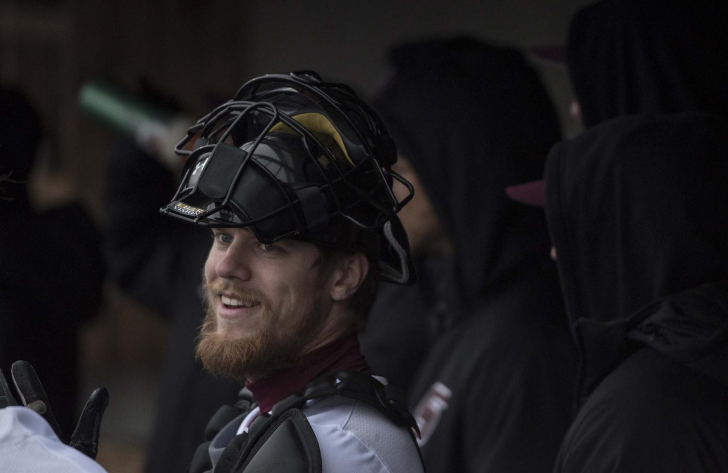 Saluki+catcher+Colin+Butkiewicz+talks+and+laughs+with+fellow+players+in+the+dugout+before+going+out+on+the+field++on+Friday%2C+March+1%2C+2019+during+the+Salukis%27+8-1+win+against+Western+Illinois.