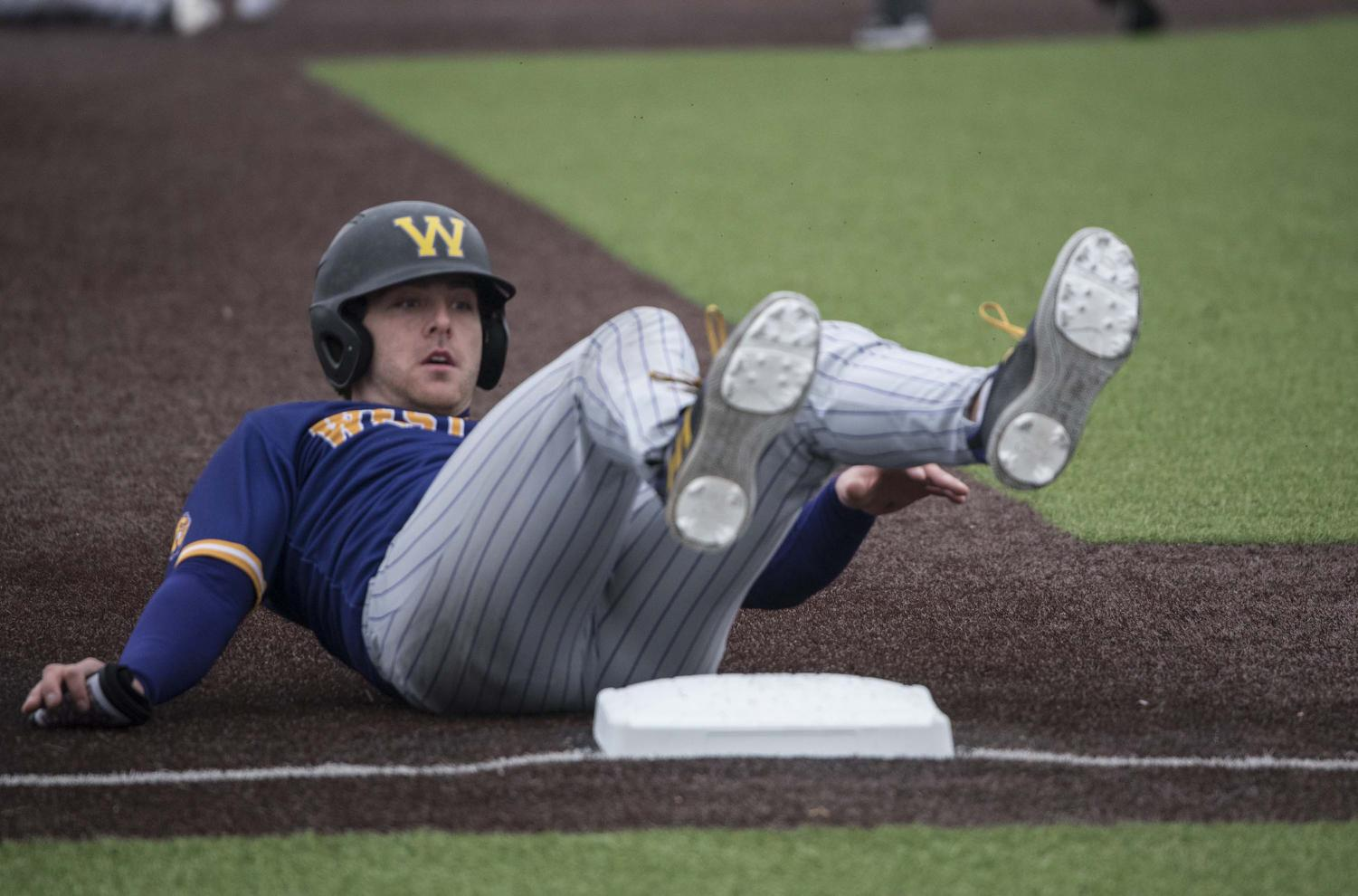 Western+Illinois+Leatherneck+CJ+Schaeffer+Jr.+slides+onto+third+base+during+the+fourth+inning++on+Friday%2C+March+1%2C+2019+during+the+Salukis%27+8-1+win+against+Western+Illinois.