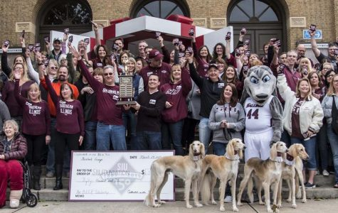 SIU presents trophy to 'BEER' scholarship creators