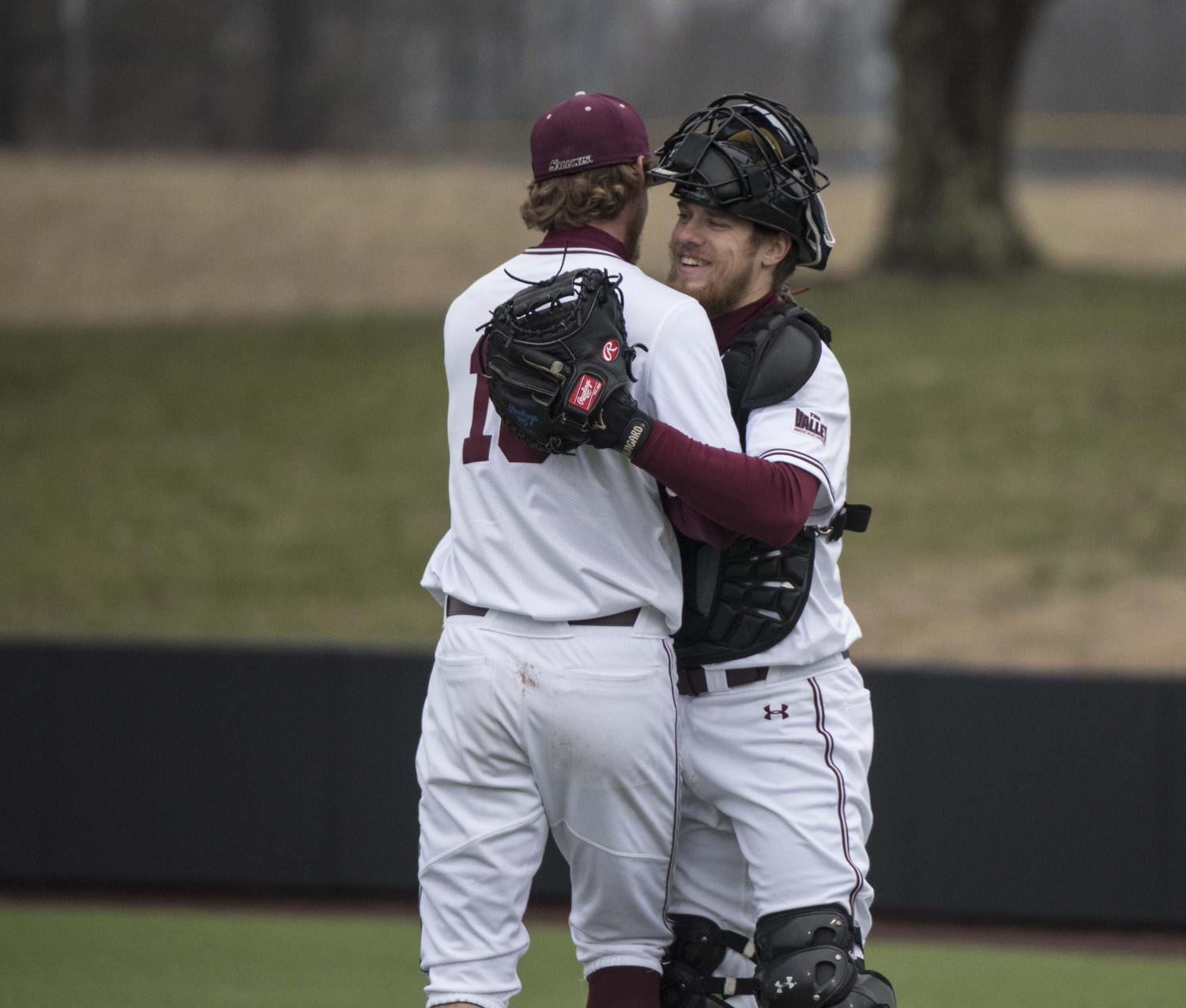 Saluki+Catcher+Colin+Butkiewicz+and+pitcher+Matthew+Steidl+embrace+at+the+end+of+the+tenth+inning+on+Friday%2C+March+1%2C+2019.+The+Salukis+won+both+matches+in+a+double+header+against+Western+Illinois+University.+