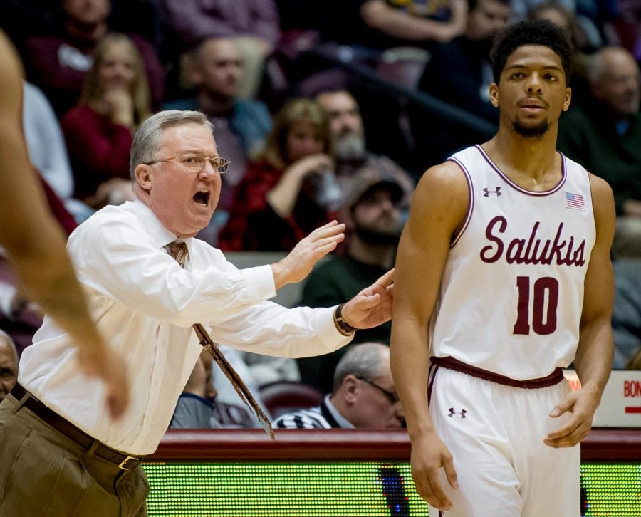 Southern Illinois Salukis head coach Barry Hinson coaches Southern Illinois Salukis guard Aaron Cook on Saturday, March 2, 2019 during the Southern Illinois Salukis' 72-63 win over the Illinois State Redbirds at SIU Arena in Carbondale, Illinois.
