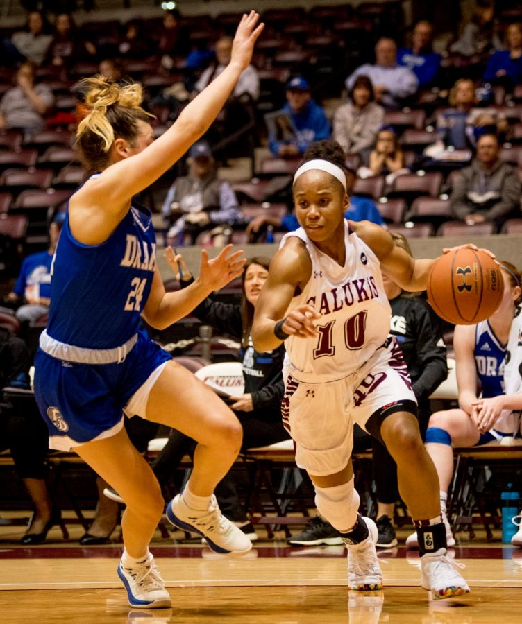 Southern Illinois Salukis guard Brittney Patrick drives the ball past Drake Bulldogs guard Nicole Miller on Friday, March 1, 2019, during a matchup between the Southern Illinois Salukis and the Drake Bulldogs at SIU Arena.