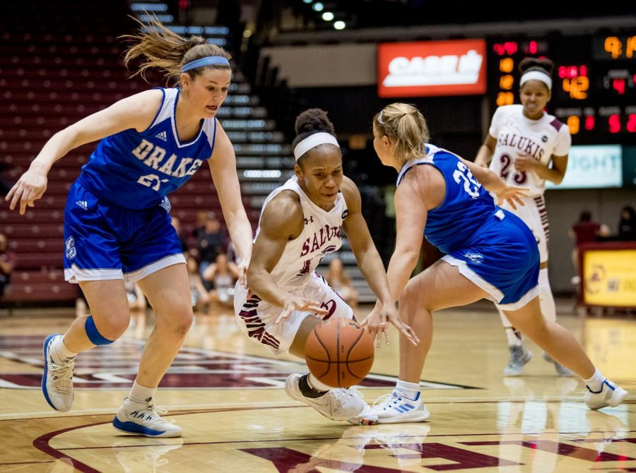 Southern+Illinois+Salukis+guard+Brittney+Patrick+attempts+to+drive+the+ball+past+Drake+Bulldogs+guard+Sammie+Bachrodt+and+Drake+Bulldogs+guard+Hannah+Fuller+on+Friday%2C+March+1%2C+2019%2C+during+a+matchup+between+the+Southern+Illinois+Salukis+and+the+Drake+Bulldogs+at+SIU+Arena.