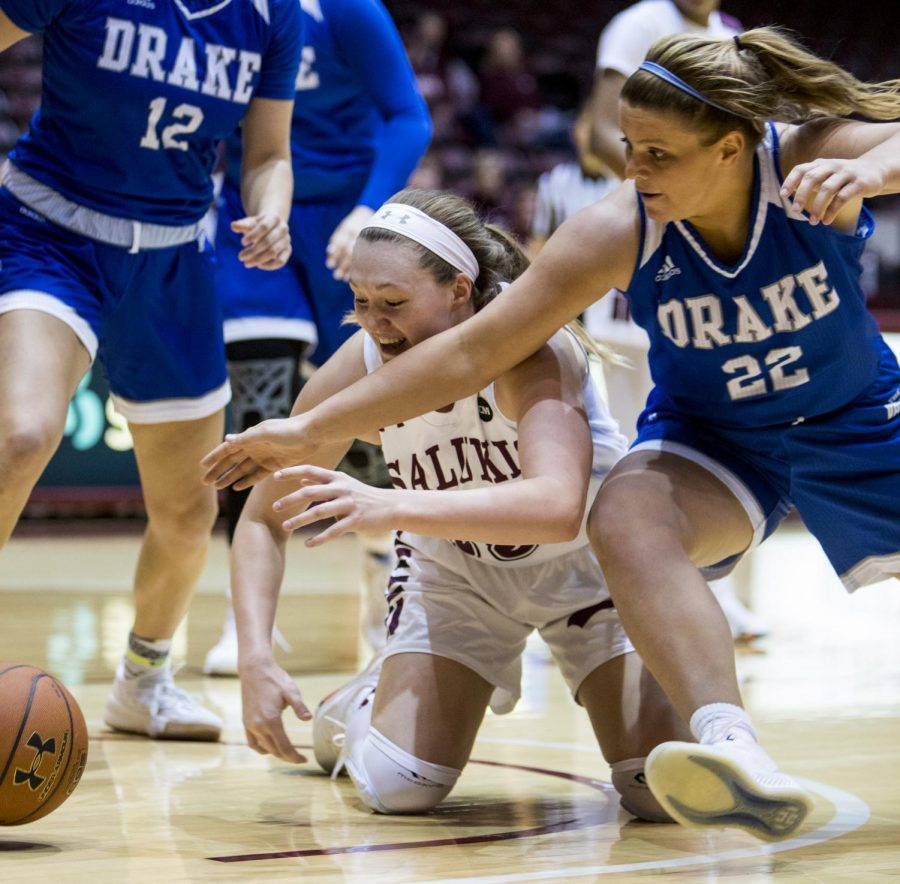 Sophomore forward Abby Brockmeyer fights for the ball on Friday, March 1, 2019, during the Salukis' 64-71 loss to the Drake Bulldogs in the SIU Arena.