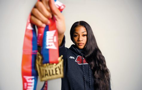 Tyjuana Eason, a sophomore majoring in psychology, poses with her medals won at the MVC Indoor T&F Championships at Cedar Falls Iowa. Where she was the top-point earner for the Saluki women.