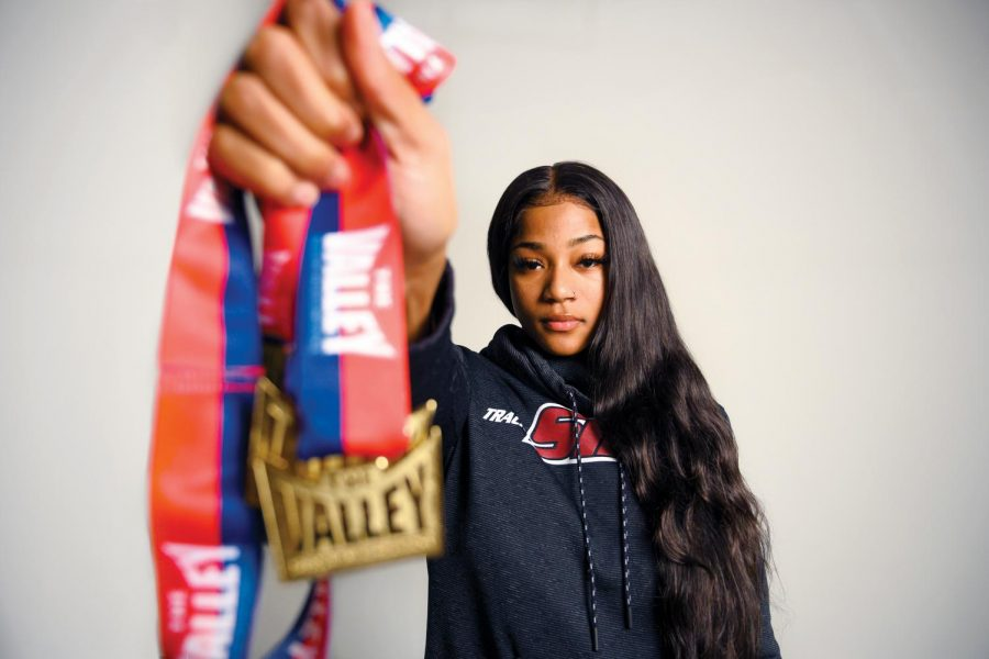 Tyjuana+Eason%2C+a+sophomore+majoring+in+psychology%2C+poses+with+her+medals+won+at+the+MVC+Indoor+T%26F+Championships+at+Cedar+Falls+Iowa.+Where+she+was+the+top-point+earner+for+the+Saluki+women.