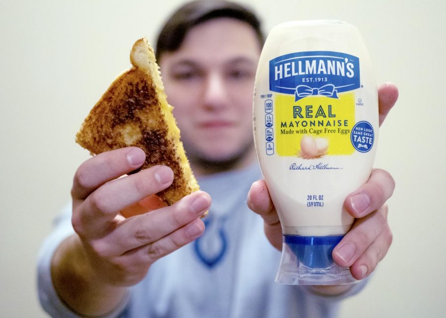 Jacob+Lorenz+holds+up+a+grilled+cheese+sandwich+and+a+jar+of+Hellman%E2%80%99s+Mayonnaise+on+April+4%2C+2019%2C+in+his+apartment+at+the+Saluki+Pointe.+