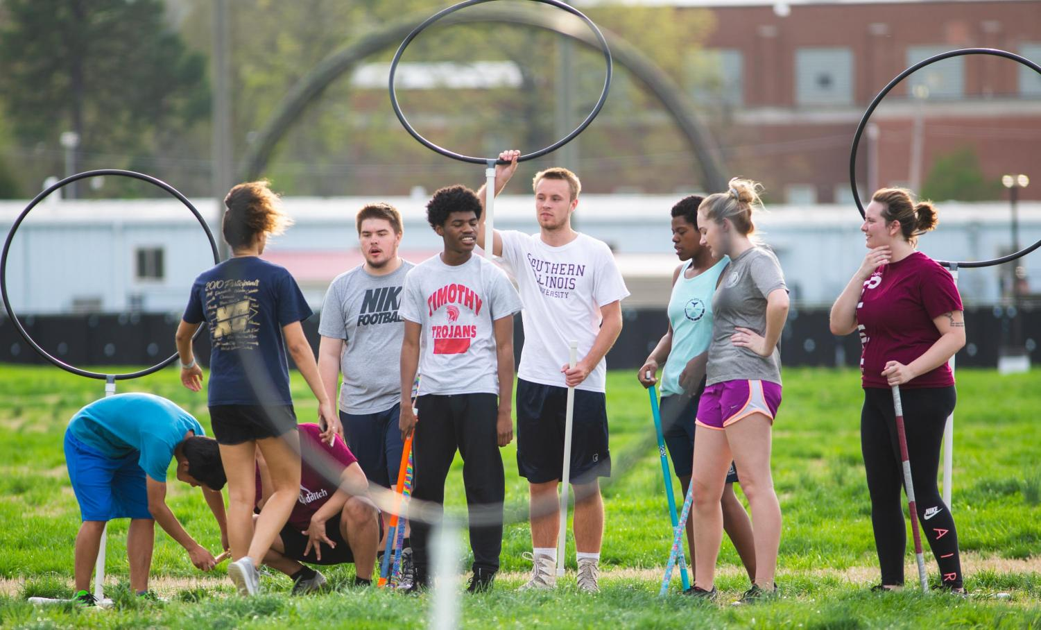 The SIU Quidditch team talks among themselves, on Thursday, April 12, 2019 during their last practice before nationals.