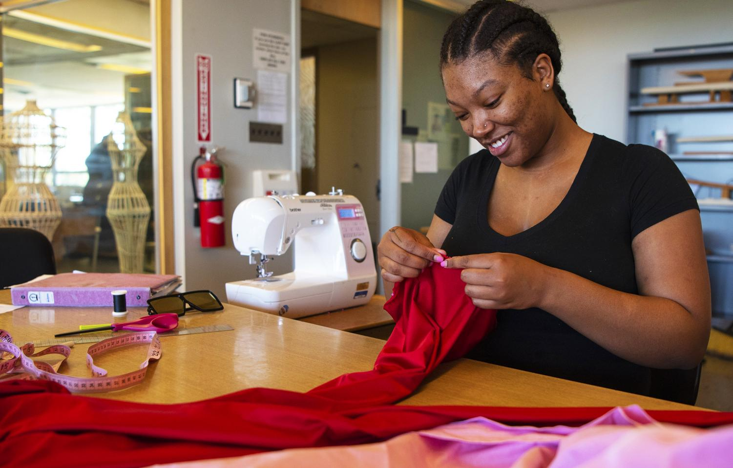 Terrian Brownlow, a senior majoring in Fashion Design, works on her fashion project on Tuesday, April 17, 2019, on the third floor of Quigley Hall.