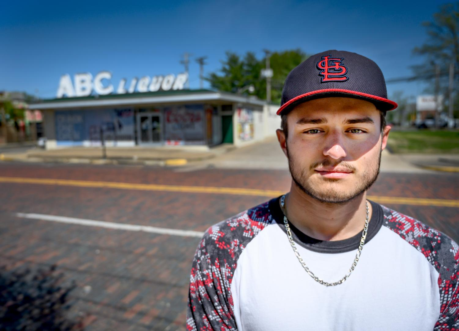 Skyler Cantrell, 21, of Altona, poses for a portrait on Tuesday, April 16, 2019, outside of ABC Liquor Mart in Carbondale. Cantrell, an Altona volunteer firefighter, was on the scene of a four person shooting late Friday night in Carbondale.