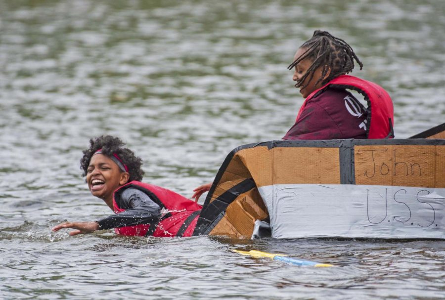 Ten-year-old+Kyla+Ford+and+eight-year-old+Kurt+Junior%2C+from+Carbondale+paddle+their+boat+on+Saturday%2C+April+27%2C+2019+at+Campus+Lake+during+the+Annual+Cardboard+Boat+Regatta.+