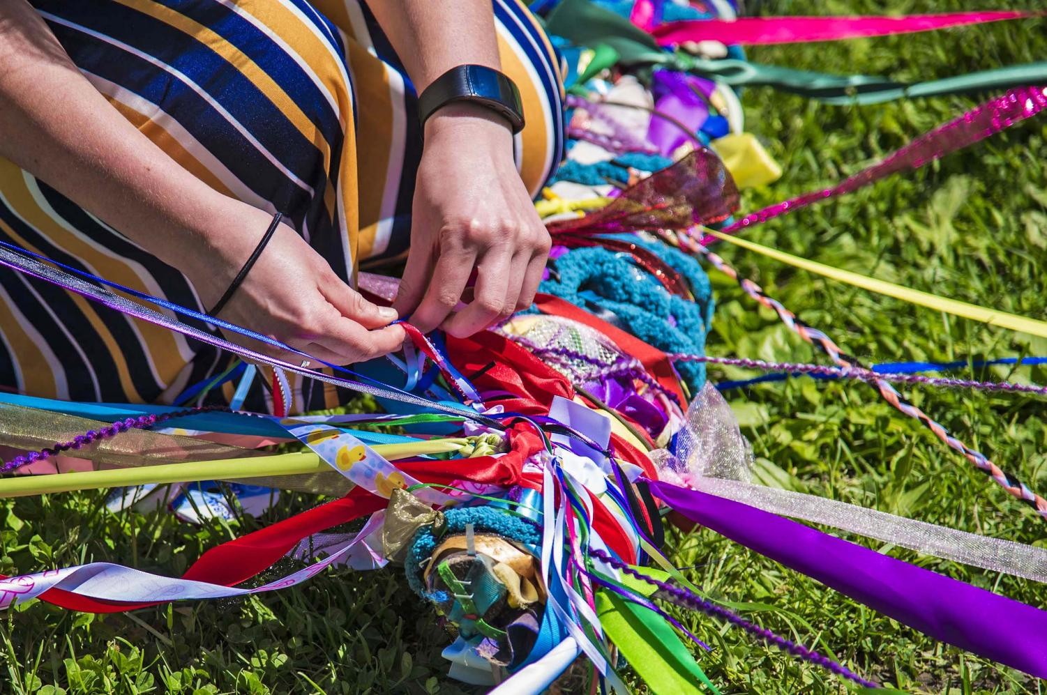 Members+of+SIPA+tie+their+ribbons+to+the+Maypole+during+the+Beltane+Ritual+at+Giant+City+State+Park+April+28%2C+2019.+The+sacred+ritual+is+to+represent+fertility+and+growth+that+will+give+way+to+good+things+in+life.+