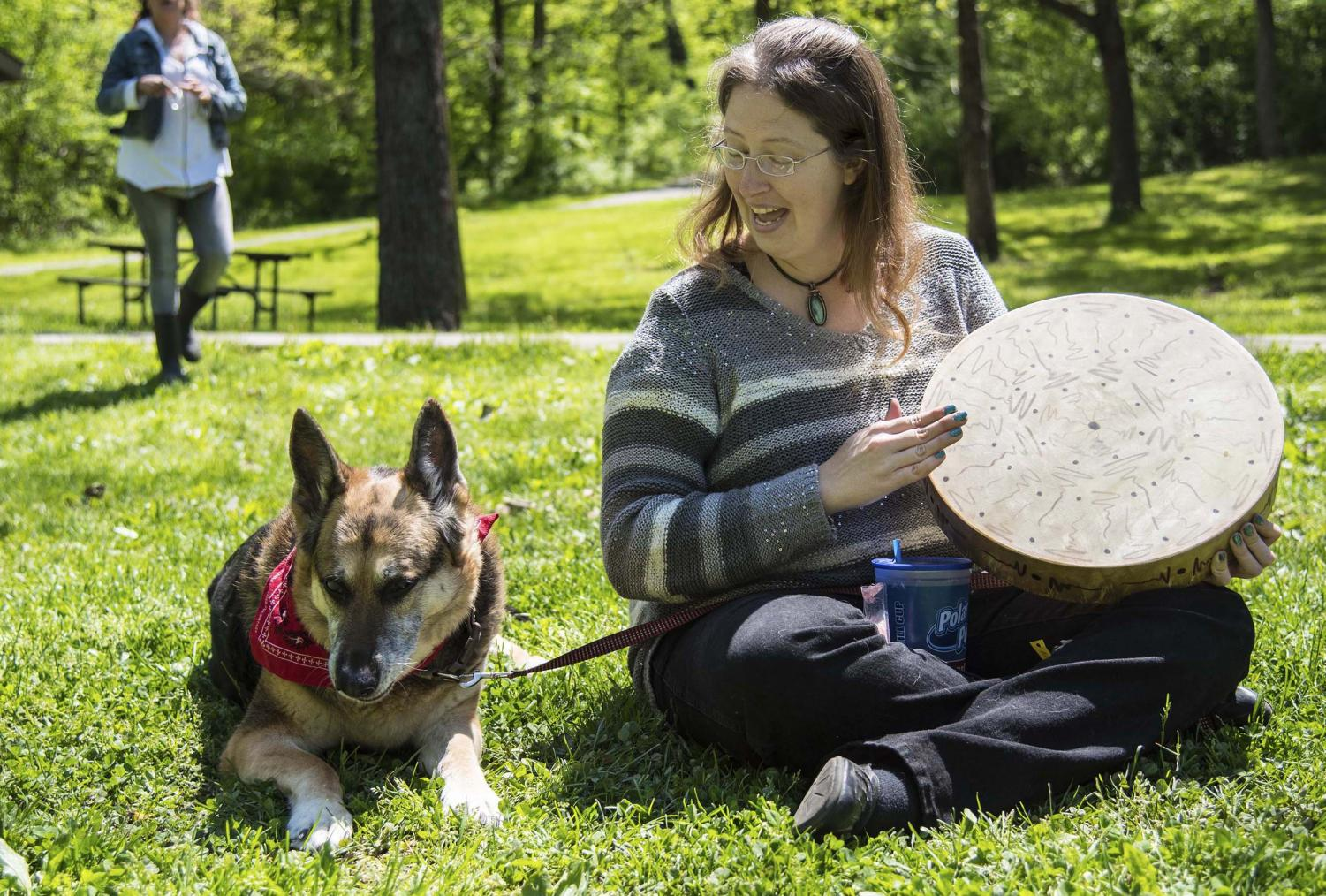 Kimberly+Castleberry+beats+on+her+drum+while+watching+the+annual+SIPA+Beltane+Ritual+at+Giant+City+State+Park+April+28%2C+2019.+