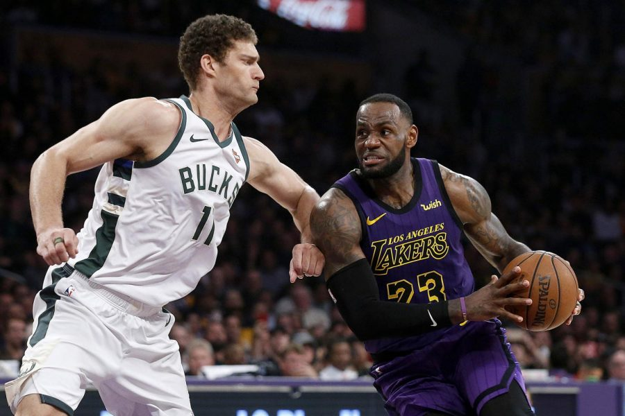 The Los Angeles Lakers' LeBron James (23) drives to the basket against the Milwaukee Bucks' Brook Lopez (11) in the second half at Staples Center in Los Angeles on Friday, March 1, 2019.