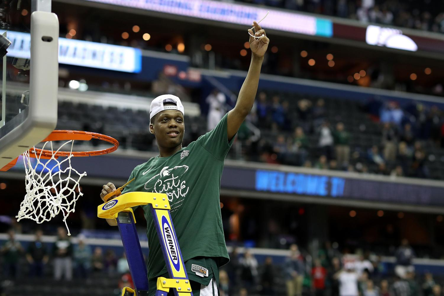 Cassius Winston (5) of the Michigan State Spartans celebrates by cutting down the net after defeating the Duke Blue Devils in the East Regional Final of the 2019 NCAA Men's Basketball Tournament on Sunday, March 31, 2019 at Capital One Arena in Washington, D.C. The Michigan State Spartans defeated the Duke Blue Devils 68-67.