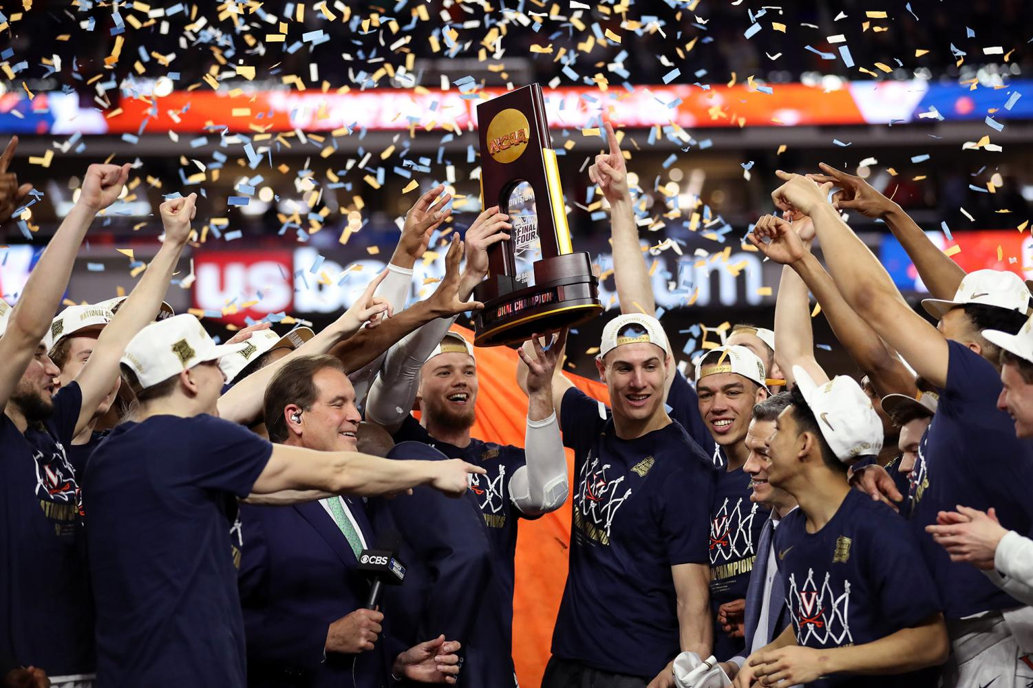 The Virginia Cavaliers celebrate with the trophy after their 85-77 win over the Texas Tech Red Raiders during the 2019 NCAA men's Final Four National Championship game at U.S. Bank Stadium on April 8, 2019 in Minneapolis, Minn.