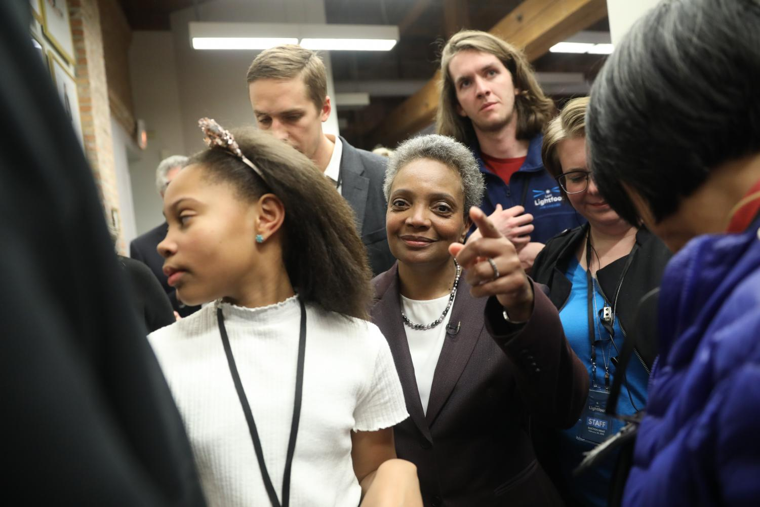 Mayoral candidate Lori Lightfoot and her daughter Vivian Lightfoot appear with supporters Tuesday night, Feb. 26, 2019 at EvolveHer in Chicago.