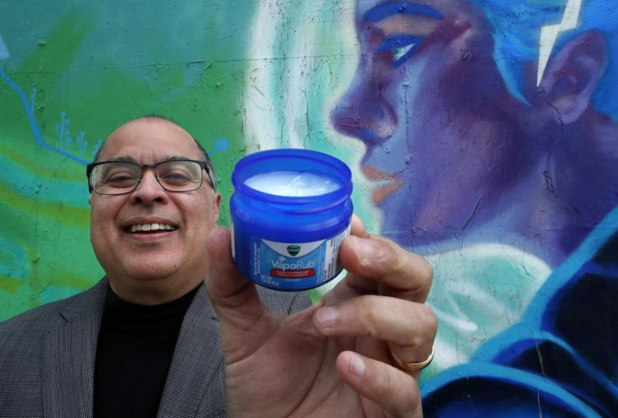 Daniel+Olivas+holds+a+jar+of+Vicks+VapoRub+near+his+office+in+downtown+L.A.+When+Olivas+caught+a+cold+as+a+child%2C+he+recalls%2C+his+mother+pulled+the+blue+jar+from+the+medicine+cabinet%2C+slathered+the+ointment+on+his+chest+and+put+him+to+bed+in+a+haze+of+eucalyptus.